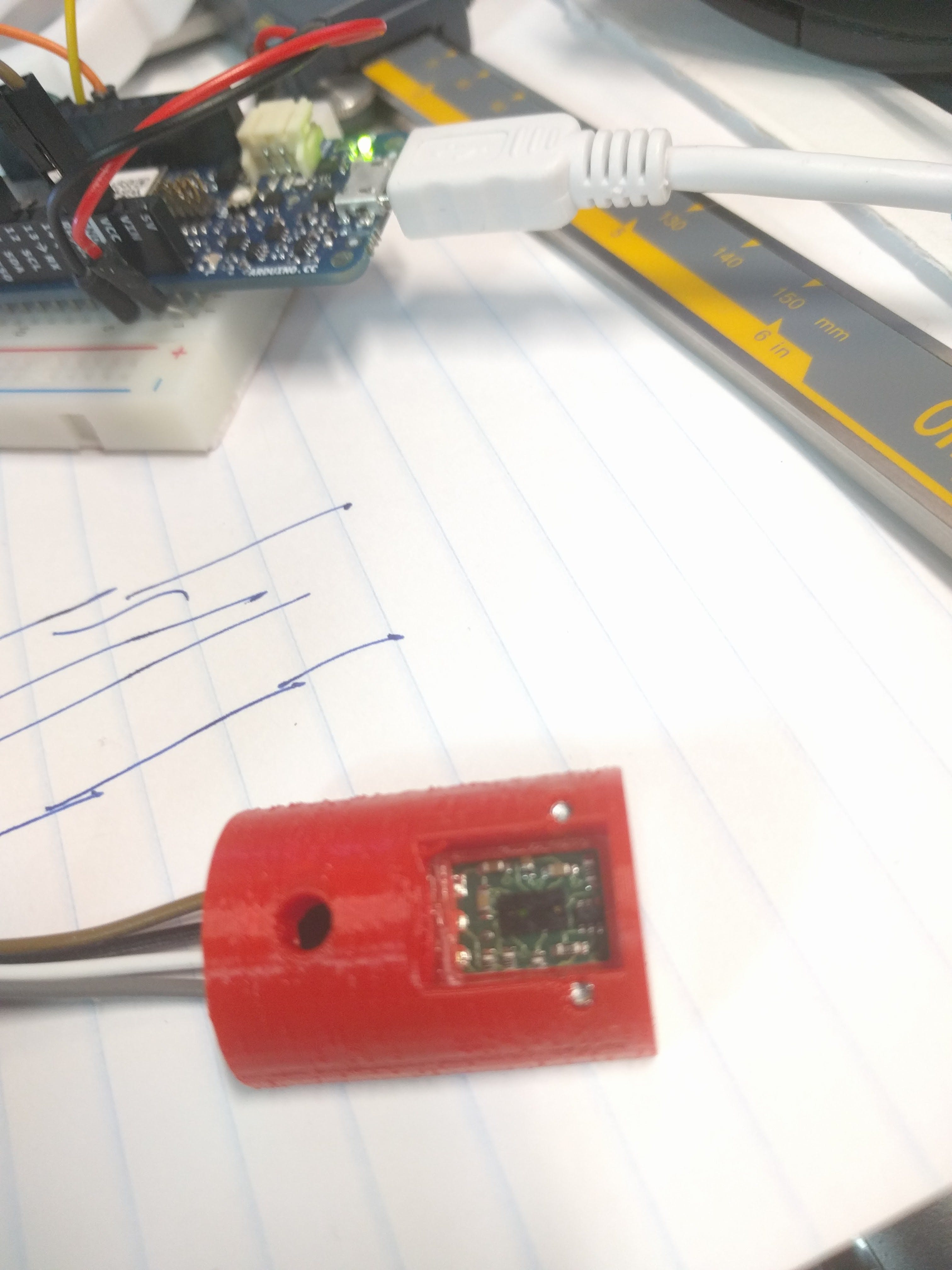 A transparent plastic shield is mounted in front of the VL6180 board to make it water proof