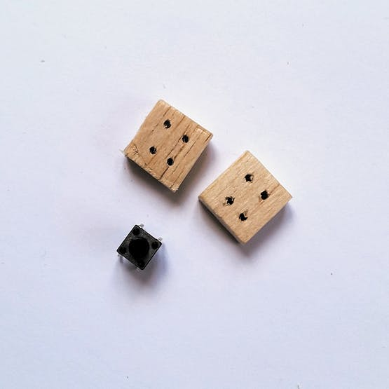 Drill holes through both blocks to match the button connectors.