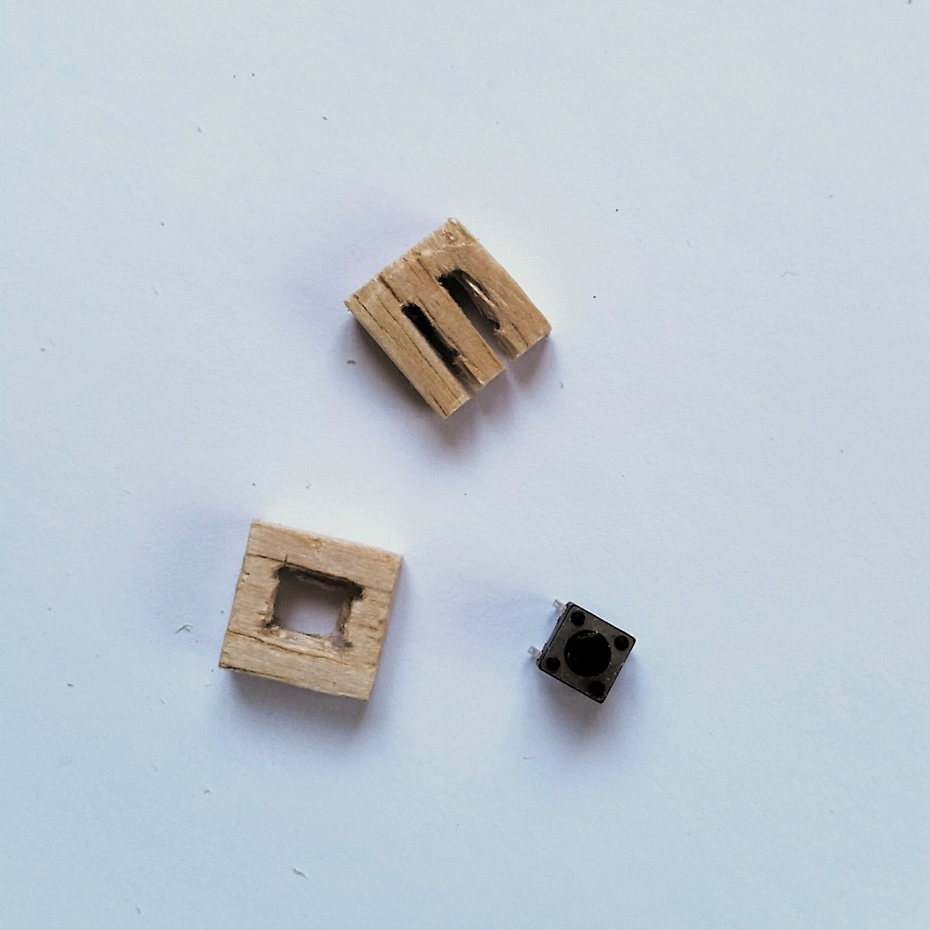 Cut one set of holes to a square, turn the others into a pair of slots.