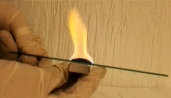 Flame color change to red after a magnetic field was applied from below the flame