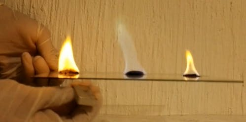 Color of the flame before (middle) and after (sides) the magnetic field was applied