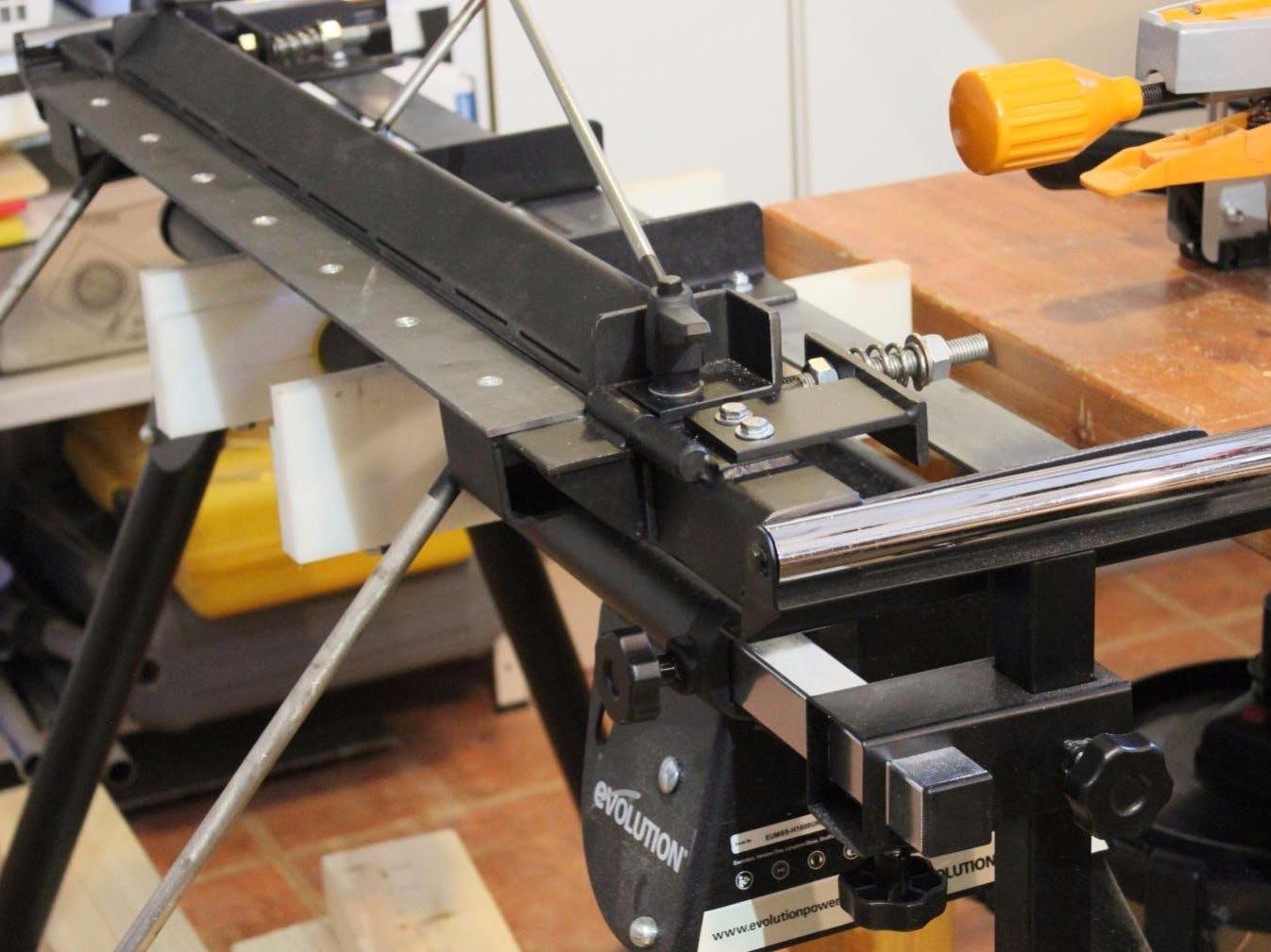 Sheet metal bending brake with radius adjustment.
