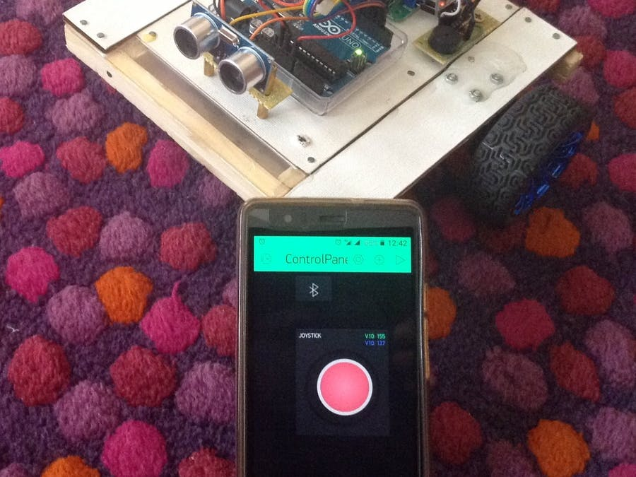 Rover Robot Controlled by a Blynk App from a Mobile
