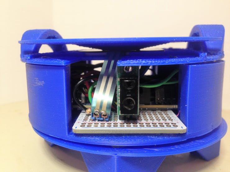 This is a side view of the Arduino 101 circuit and enclosure. This shows the Sharp IR sensor and the terminal block connected to the leads of the FSR. The point of pressure, pressure plate is seen on top of the enclosure.