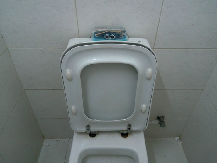 Placing the box into toilet