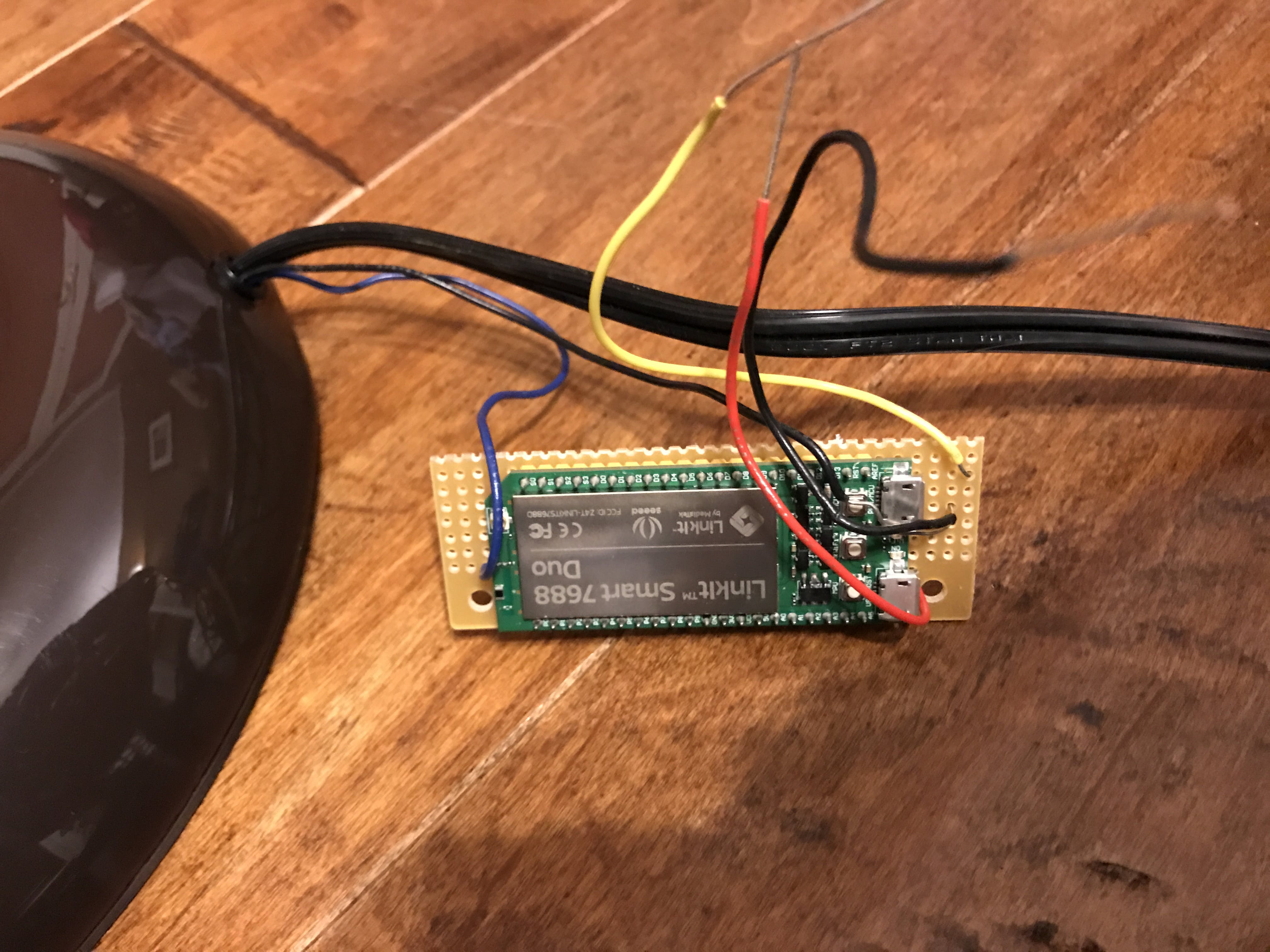 The black and blue wires from the switch were snaked through the lamp pole and connect to the Linkit and the base.