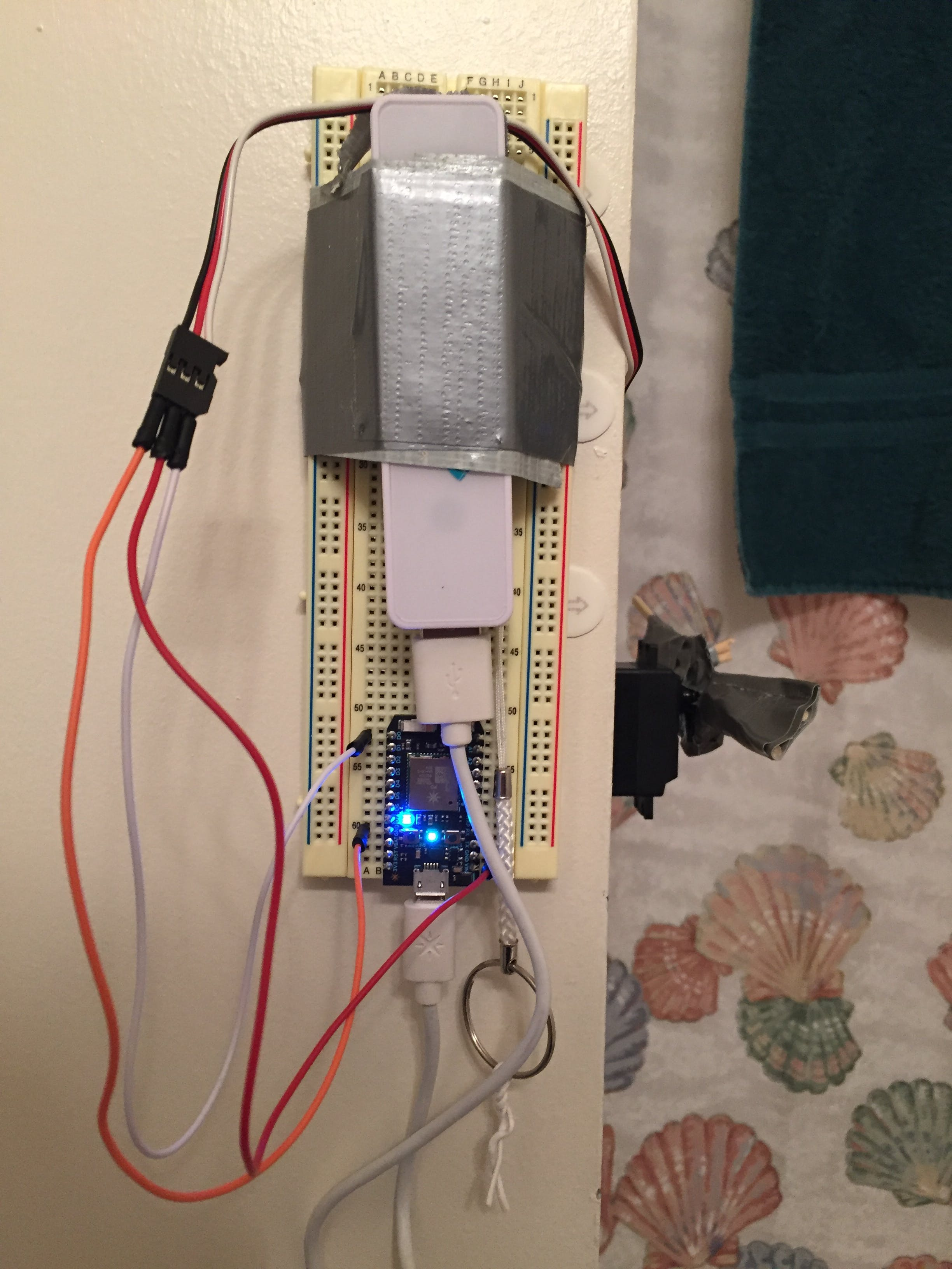 Photon 2 with servo motor and power bank connected.