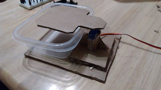 Servo-powered trap door