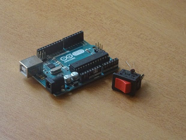 An Arduino UNO, a Photoresistor & a Switch