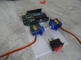 mount the arduino with tape