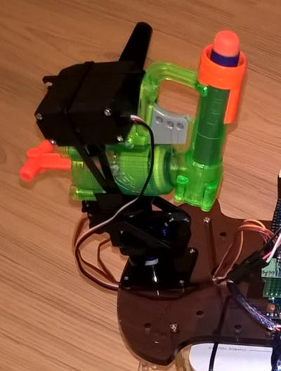 figure 3 - Nerf gun, mount, and three servos