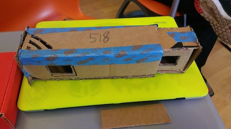 The enclosure prototyped in cardboard.