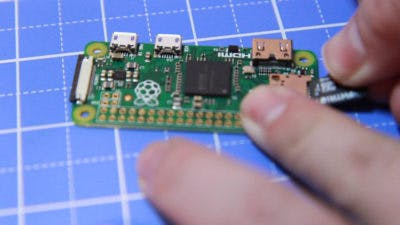 Insert SD Card with Raspbian into Raspberry Pi