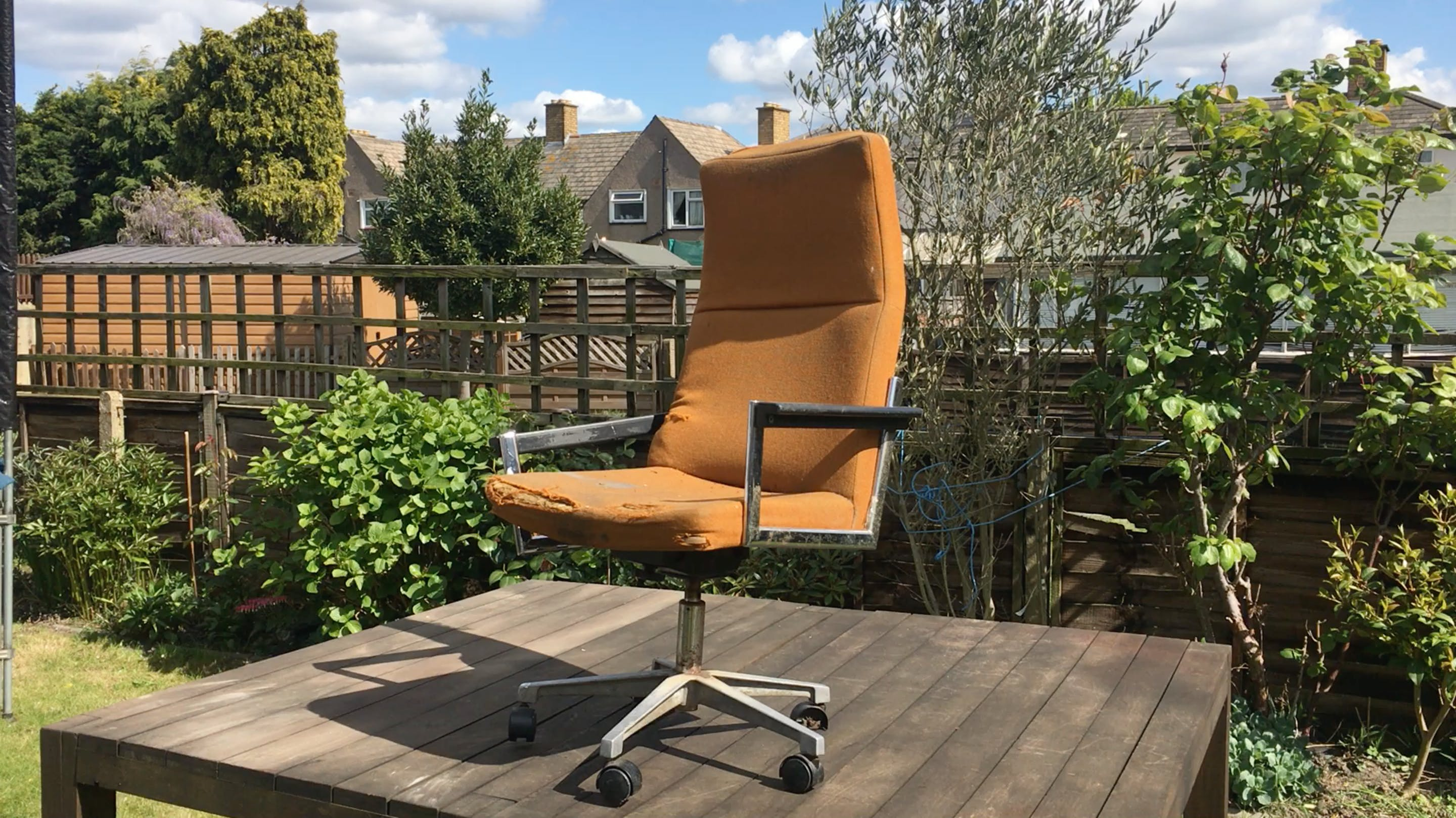 Discarded office chair with solid cast metal base