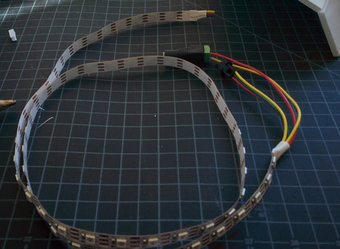 On this LED strip, the ground wire is colored yellow instead of the customary black.  It is marked where the wire attaches to the strip.