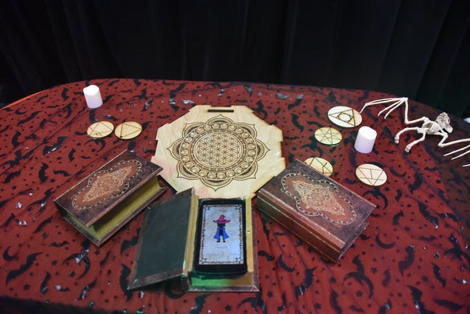spellbooks have android phones embedded; the alter reads the RFID tags of the costumes