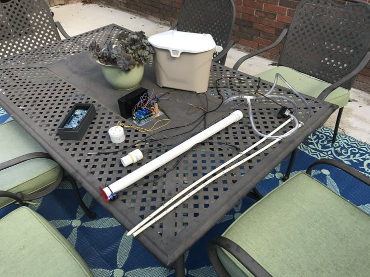 The physical components, before assembly and inserting into compost bin