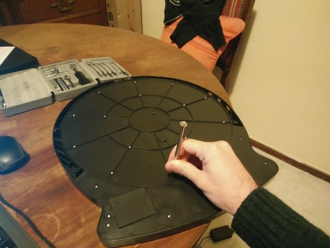 Opening the dartboard is easily achieved by unscrewing several screws on the back.
