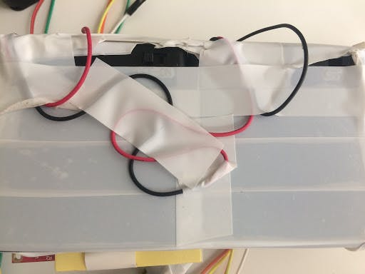Wires of the two boxes tied and taped together.