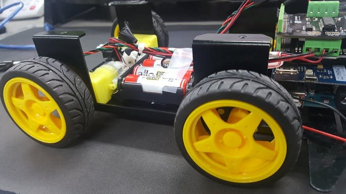 The vehicle with an Arduino Uno, PHPoC Wifi Shield, two DC motor drivers and a 7.5V batteries.