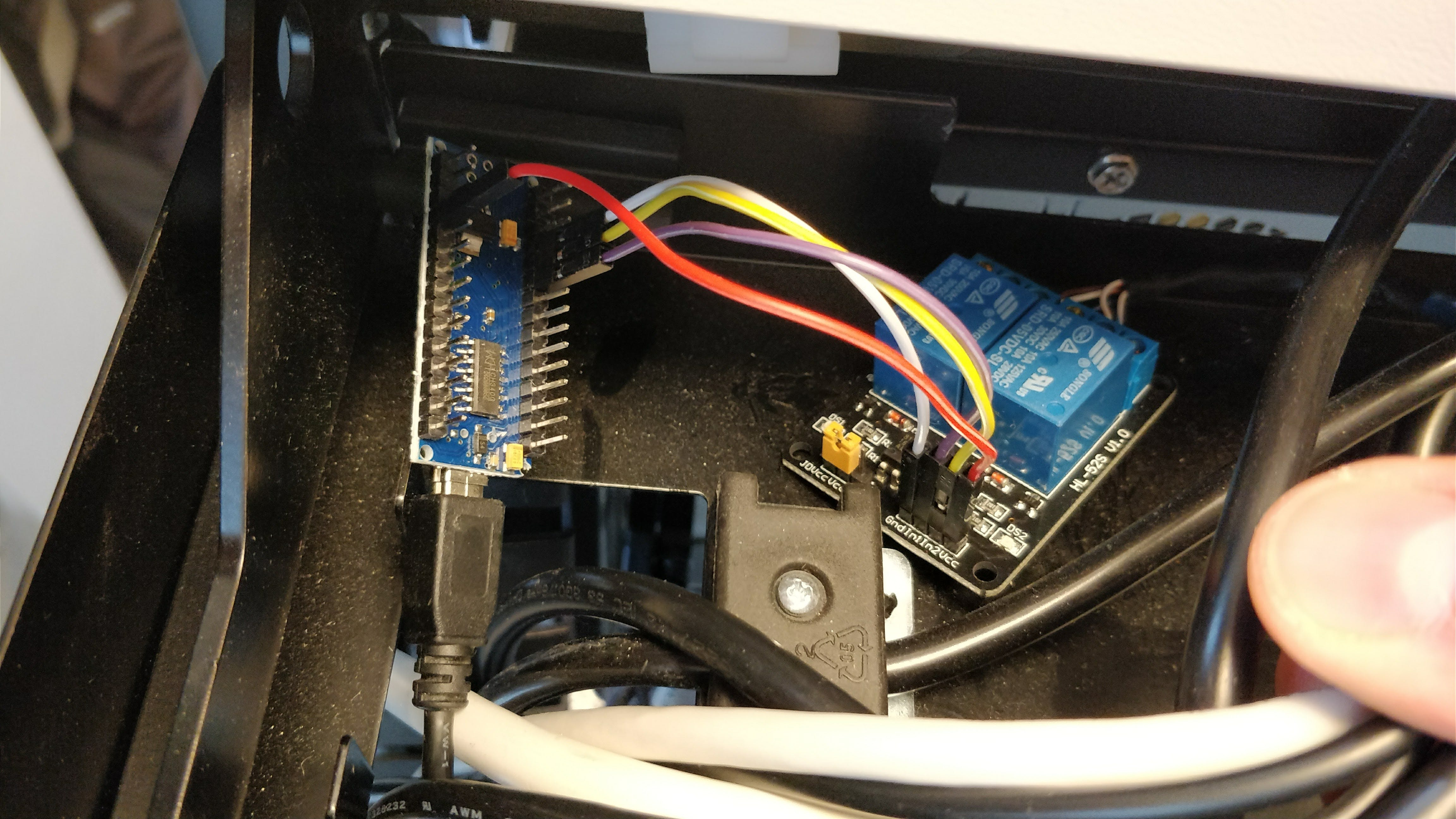 Arduino and 2 channel relays module in the cable channel behind the desk