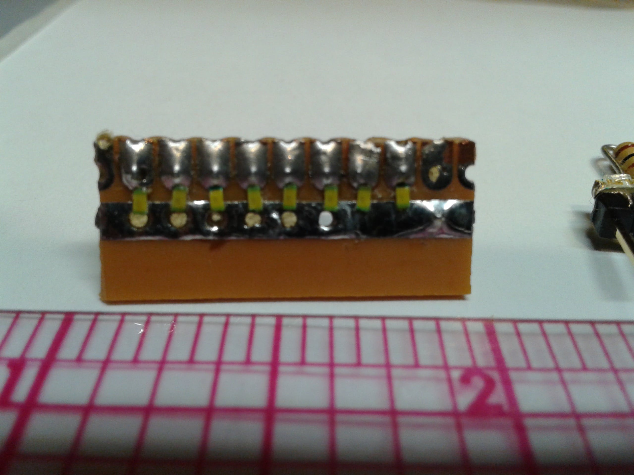 Scrap of protoboard used to mount LEDs
