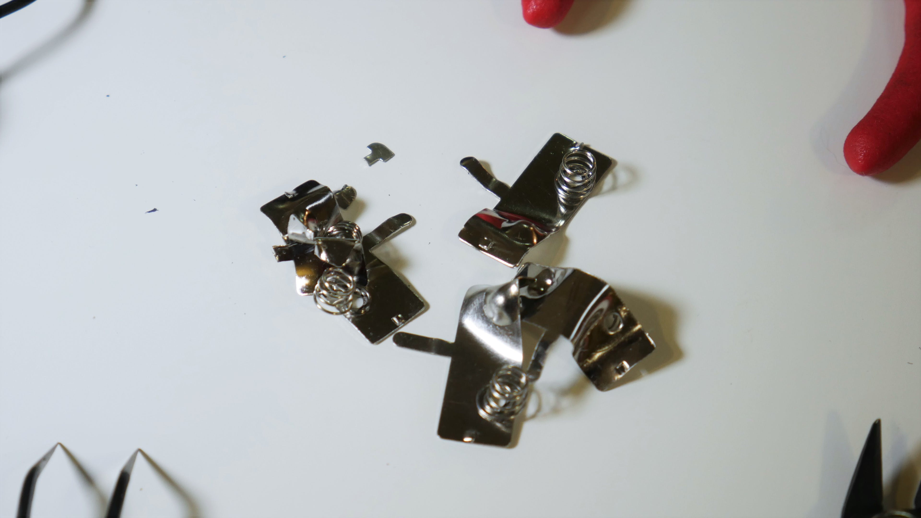 What remains of the AA battery terminals