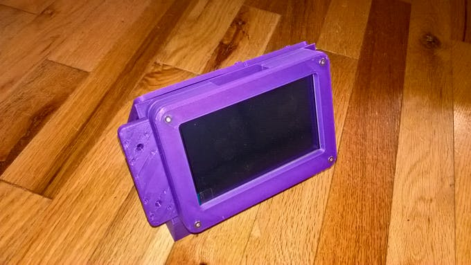 """The display bezel and the case with the 5"""" display (bolted together)"""