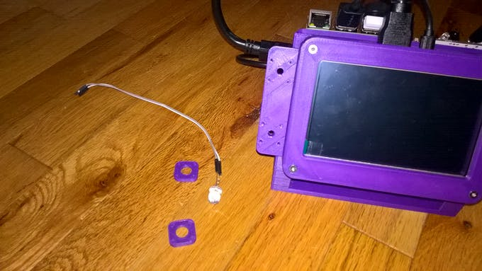 A 5mm LED and some bezels to secure it to the device