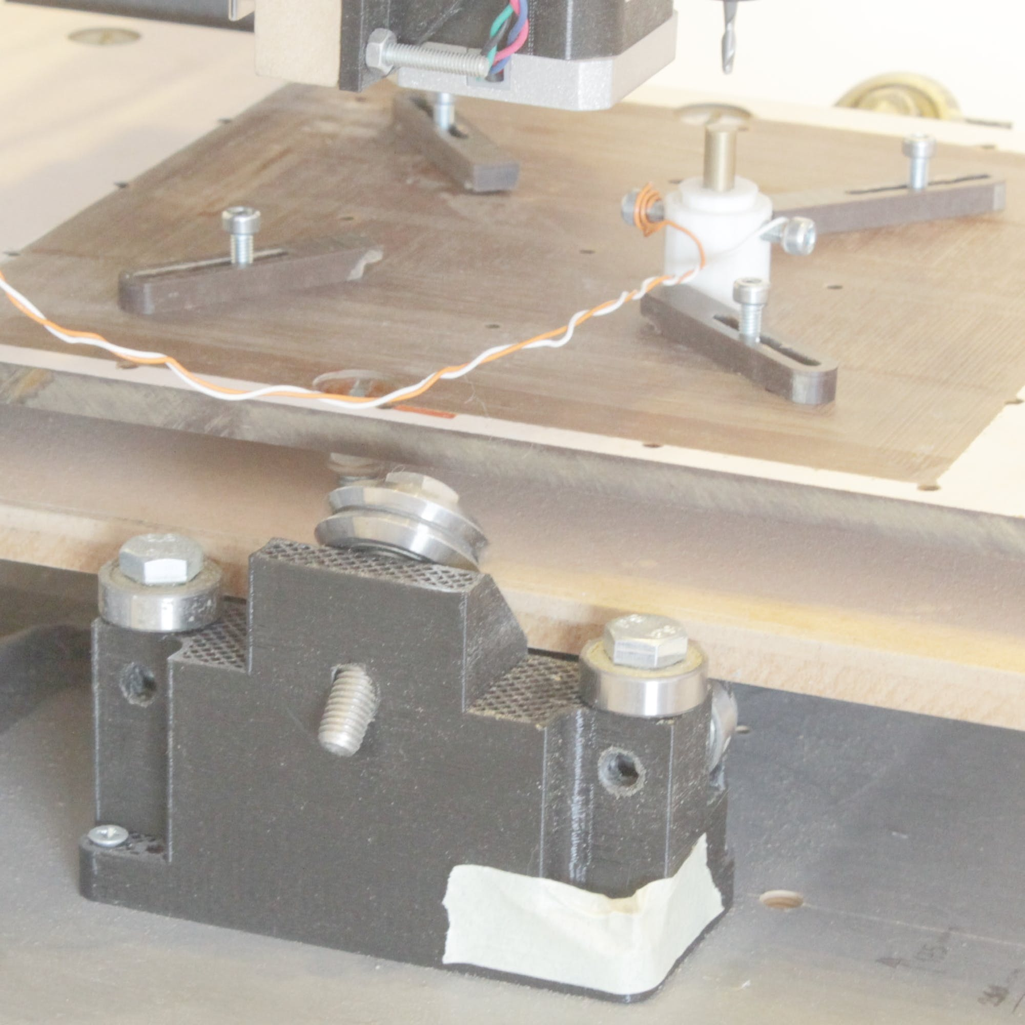 Y tray bearing's support