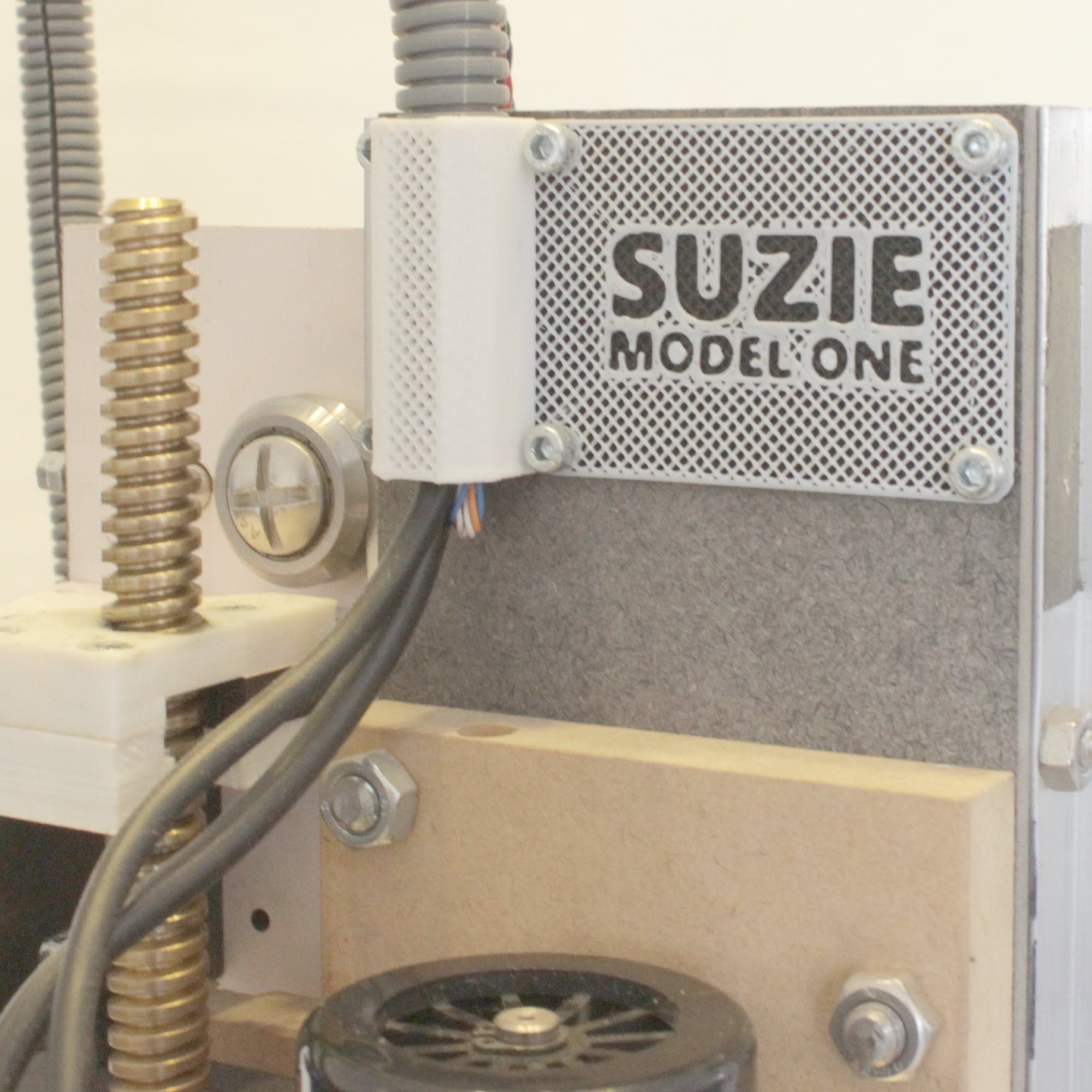 Z lead screw nut (left) and name tag with cable tube holder