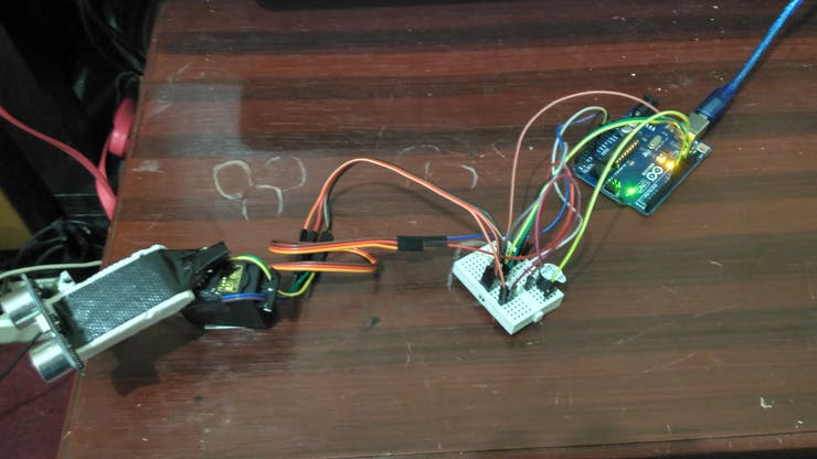 Arduino,Ultrasonik,Buzzer,Motor Servo,Kabel Jumper, Kabel USB,BreadBoard