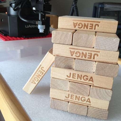 The arm's suction cup can also lift and stack Jenga pieces