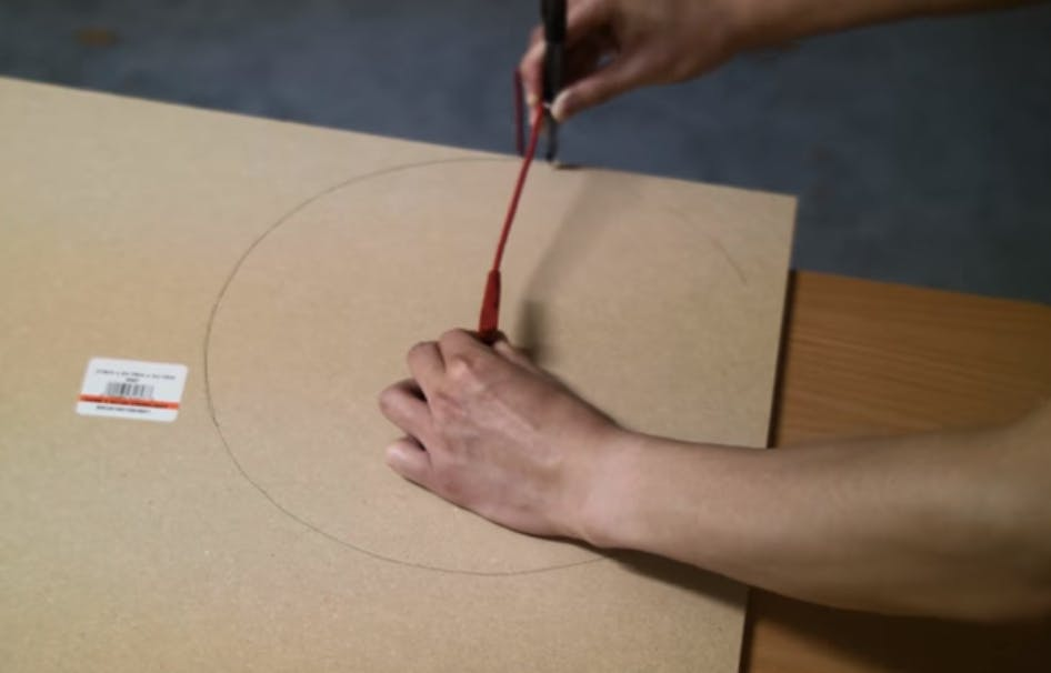 Trace out two 9-inch circles of the MDF board