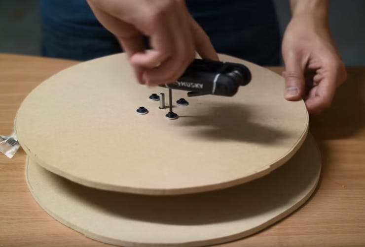Mount the motor to the drilled MDF board using four M3 screws and washers