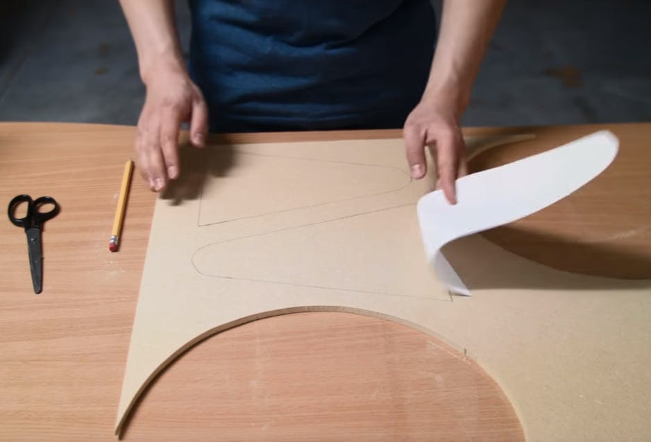 Trace the shape of the turret legs on the MDF board