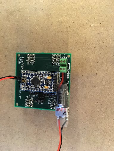 The Arduino on place and the UBEC connected to the outgoing screw terminal and the 5V header