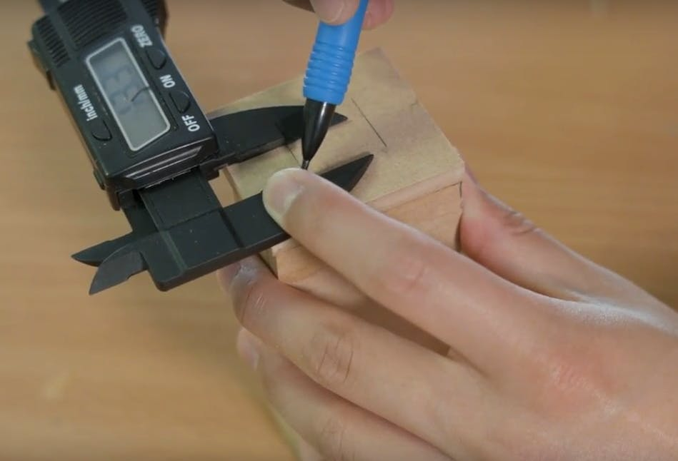 Very precisely mark the mounting hole locations for the camera module