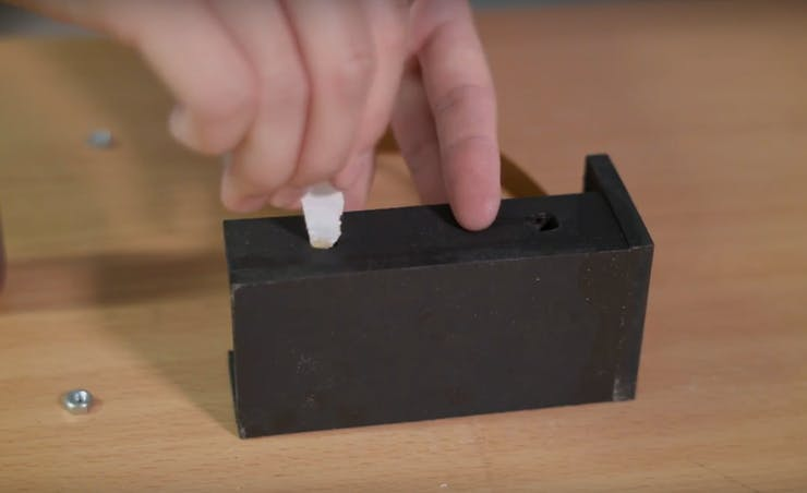 Use a cotton swab (or piece of paper) and apply glue to the inside surfaces of the two holes