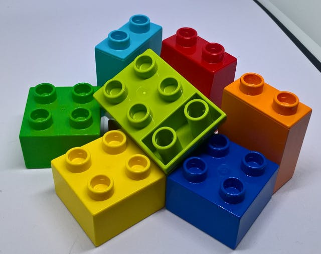 Some brightly colored Duplo Lego pieces