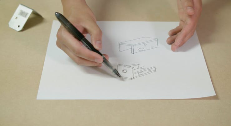 Sketch of the housing concept. Metal mounting bracket on the left