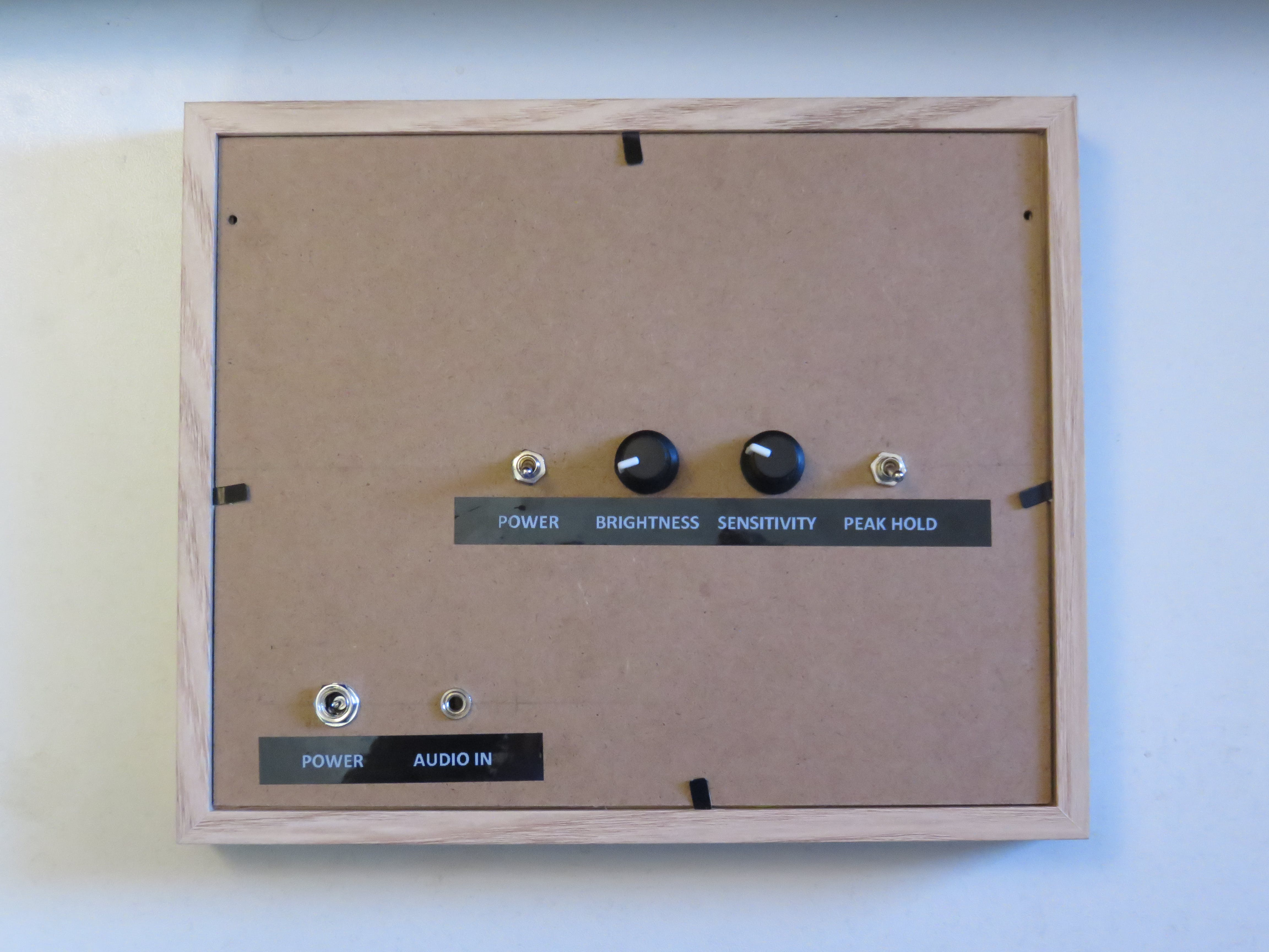 The back of the frame with 2 switches, dials and connectors.