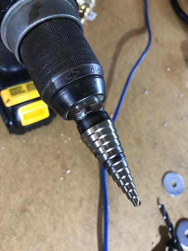 Drill the cap slowly with a reamer