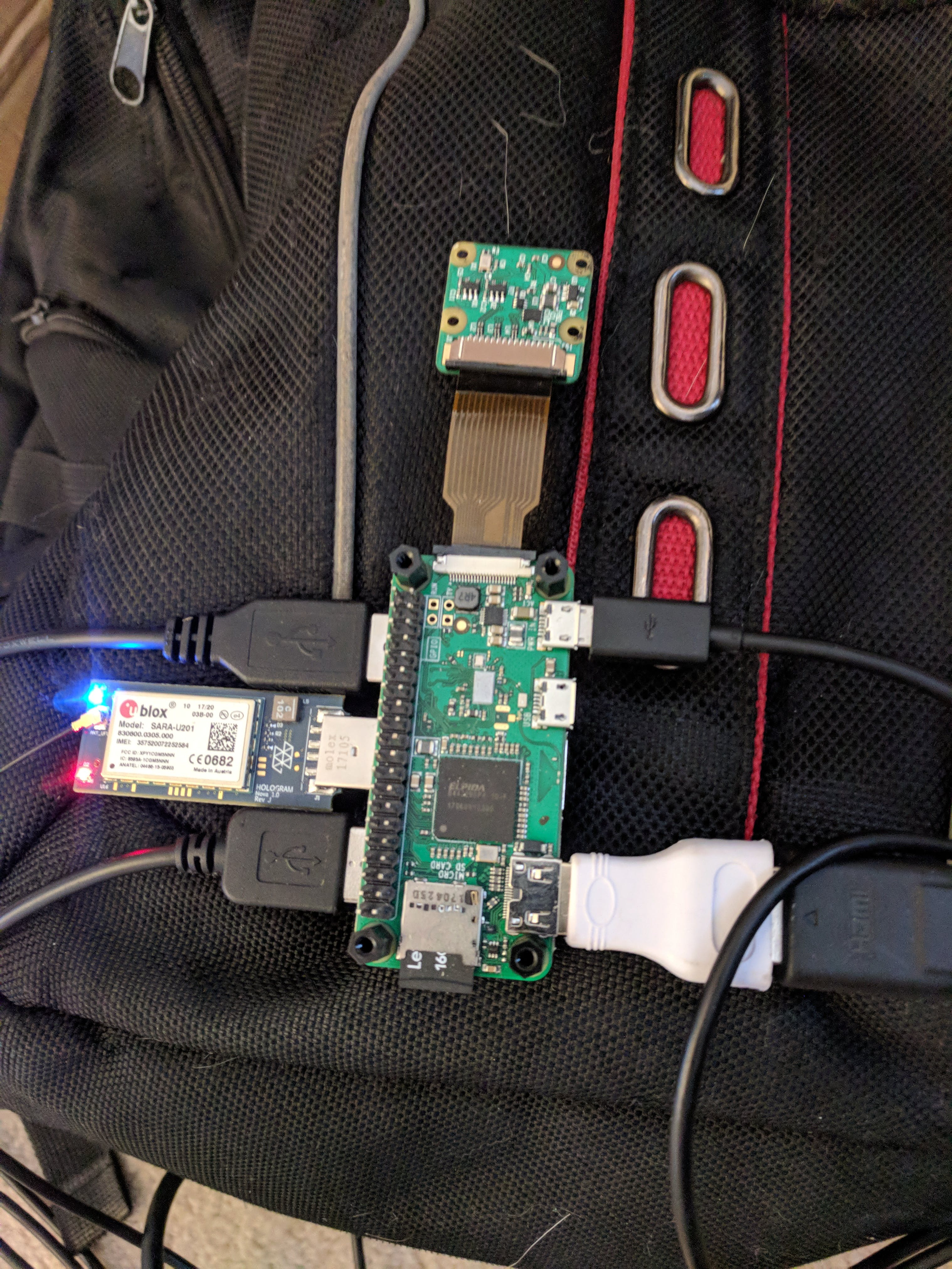 Raspberry Pi Zero W setup with camera and Hologram Nova. Note that your camera ribbon may be reversed, as I have two facing separate directions