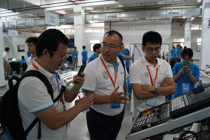 Judges having a discussion on our machine
