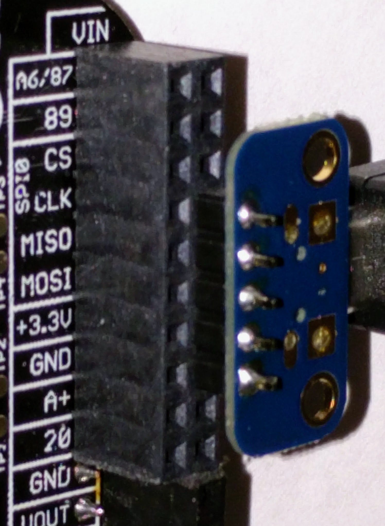 A closeup of how to plug the USB breakout board into the PocketBeagle. It is connected to pins P1_7 through P1_15.