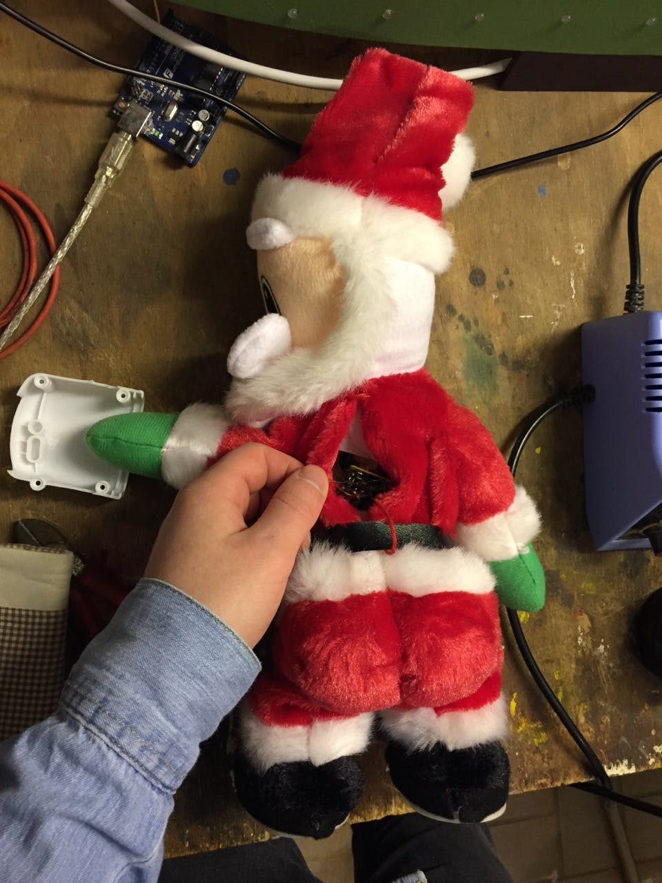 Connecting wires to Santas µC and power supply. Poor guy.