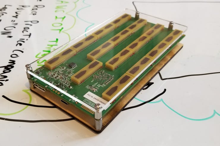 Walabot sensor with laser cut top and bottom plates.  Assemble with 2-56 screws and standoffs.
