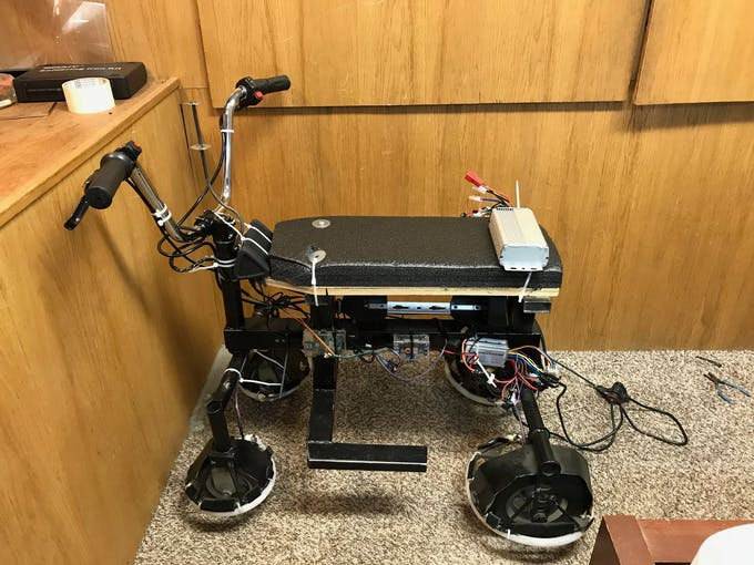 Frame with brushless dc motor, controller, battery, throttle, and secondary throttle attached.