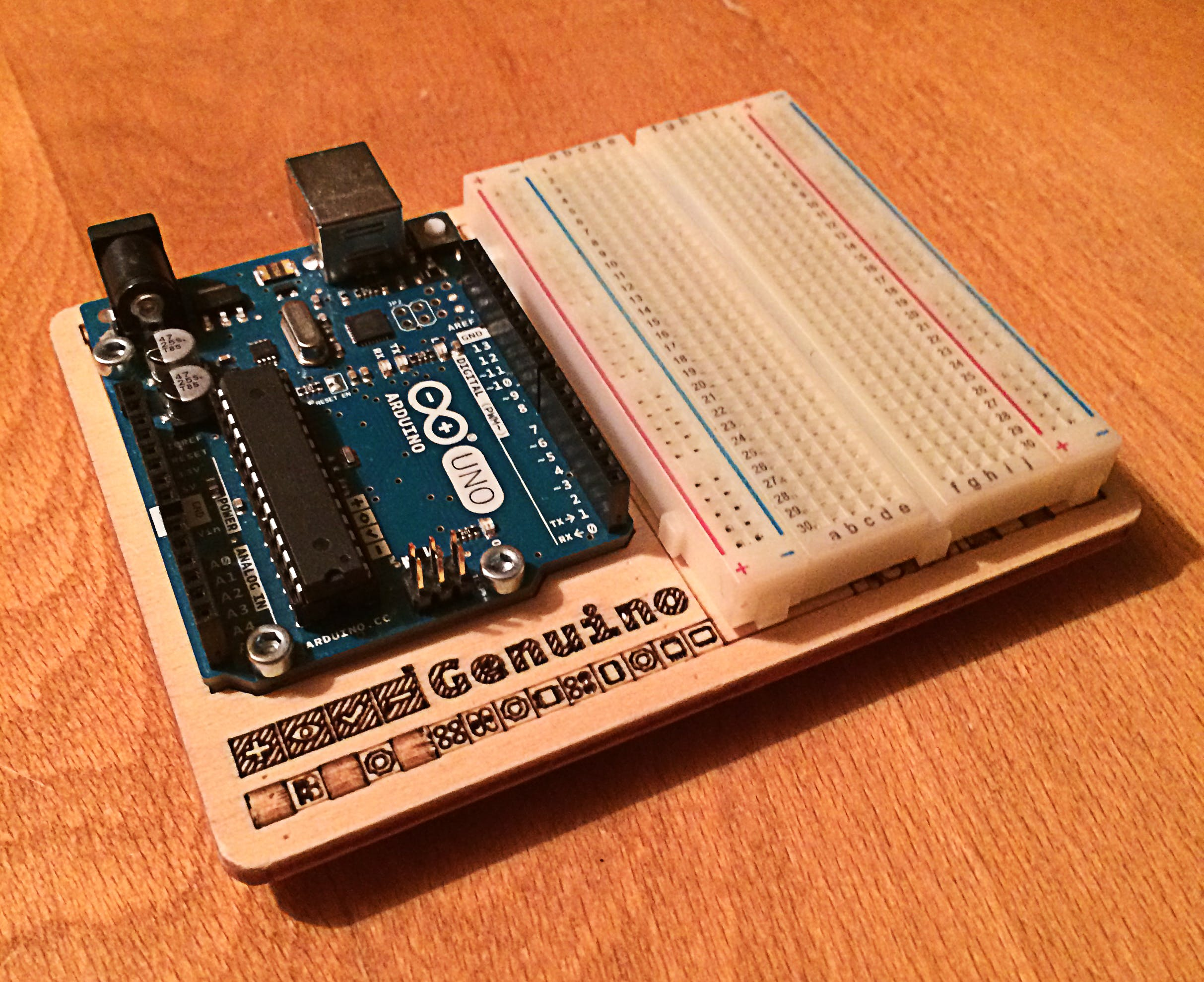 An Arduino Uno and a medium sized Breadboard, an essential for a beginner in hardware!